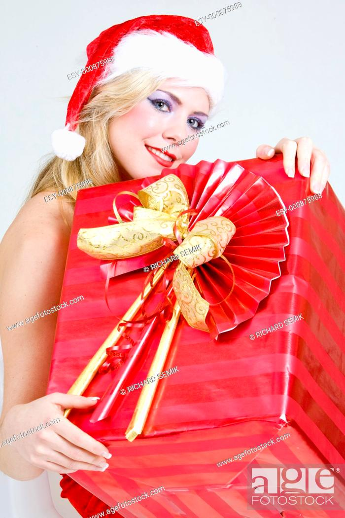 Stock Photo: Santa Claus with Christmas present.
