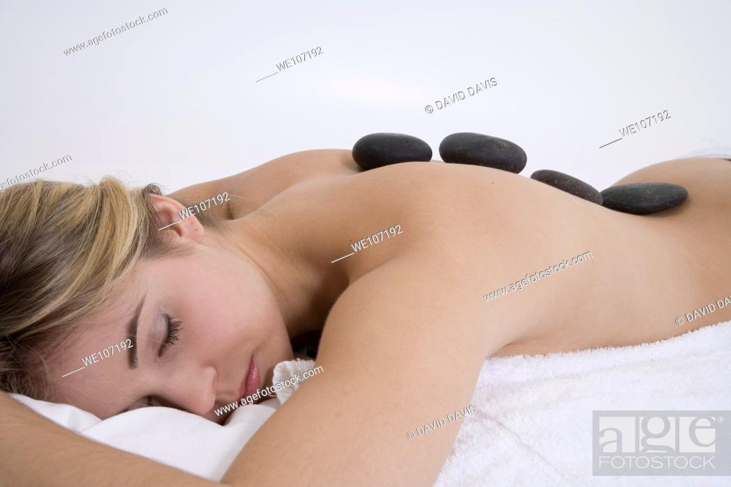 Stock Photo: Young woman having a relaxing moment during a message.