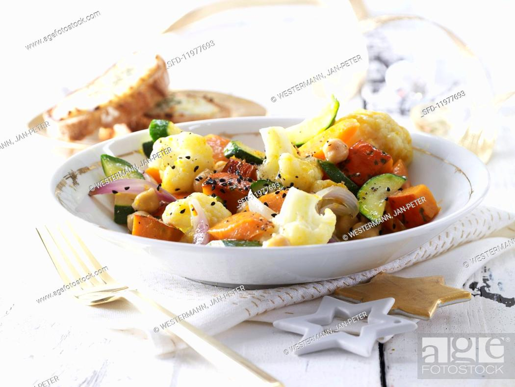 Stock Photo: Warm vegetable salad with goat's cheese croutons.