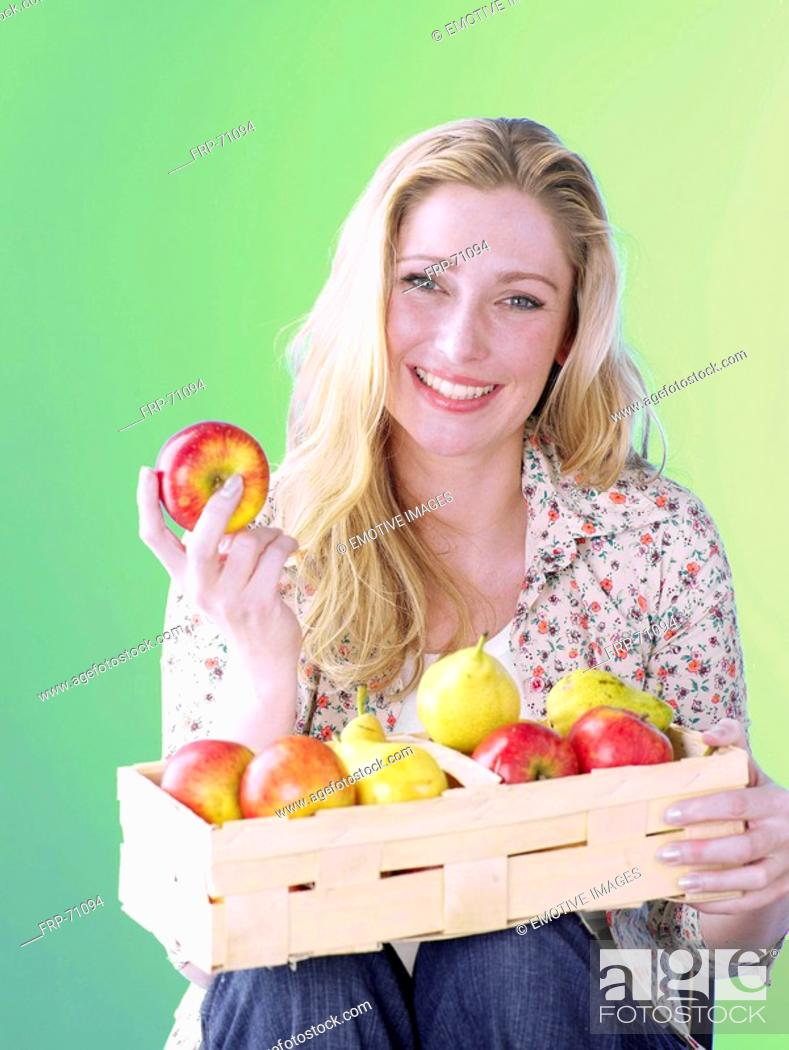 Stock Photo: Blonde woman with a fruit basket.