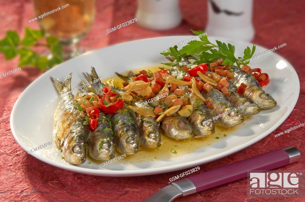 Imagen: Fried sardines with ham.