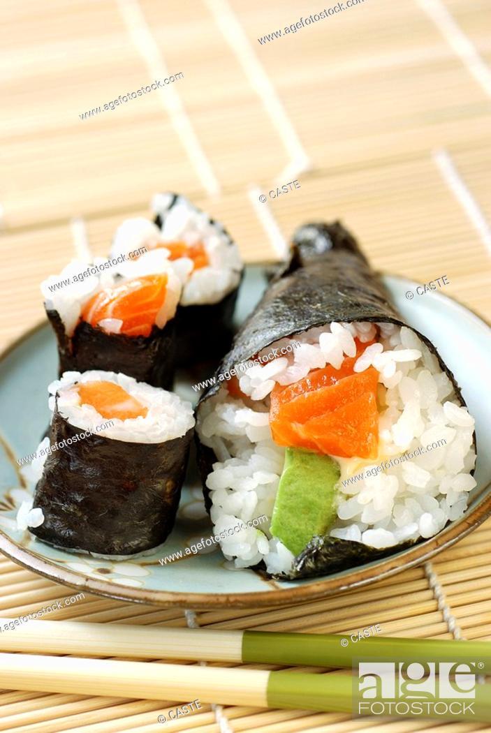 Stock Photo: Maki and a salmon and avacado cone.