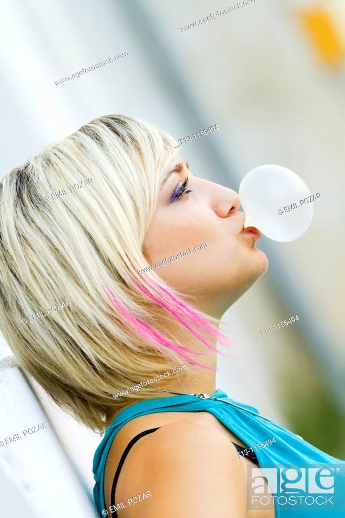 Stock Photo: Blowing a bubble gum.