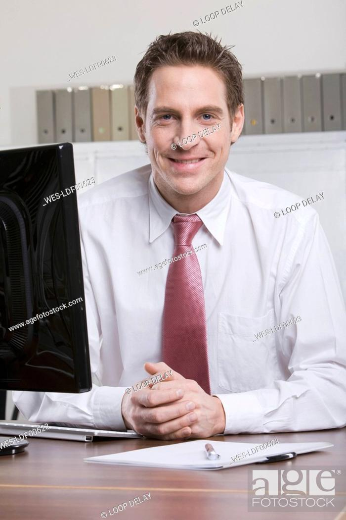 Stock Photo: Germany, Munich, business man at work.