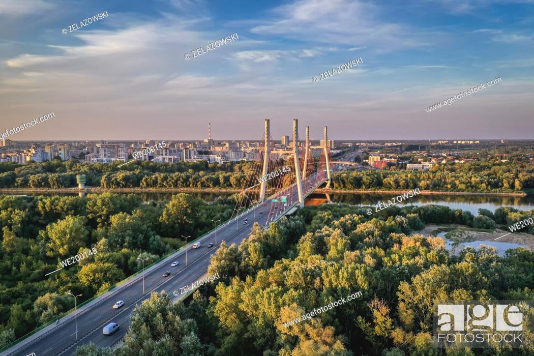 Stock Photo: Siekierkowski Bridge over Vistula River in Warsaw, Poland, Goclaw dubdistrict on background.