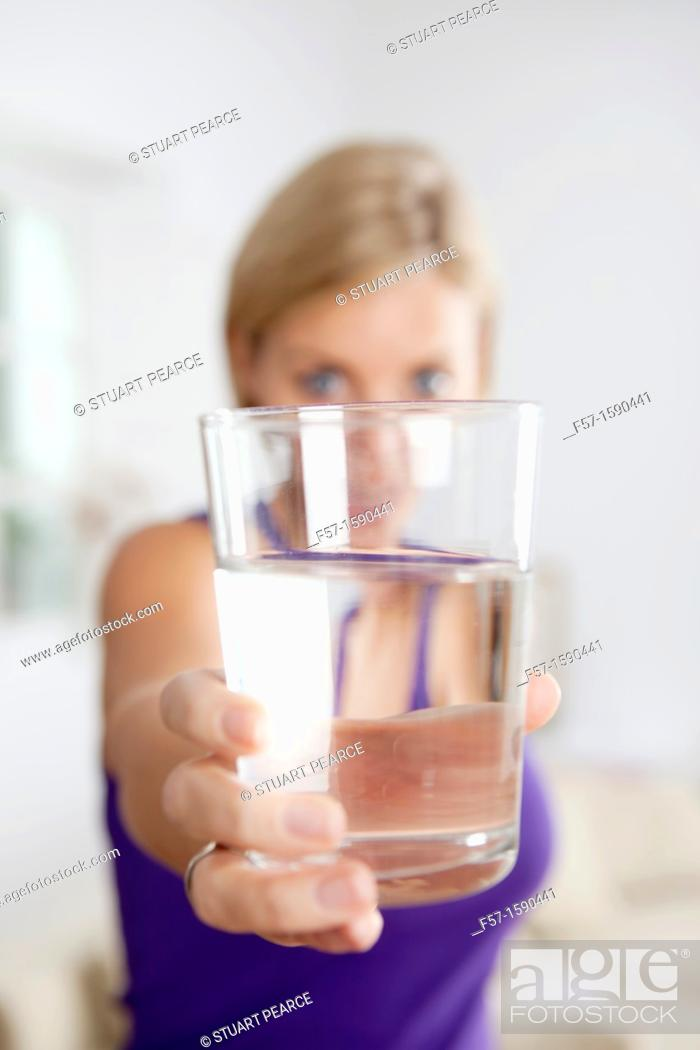 Stock Photo: Attractive young woman with glass of water.