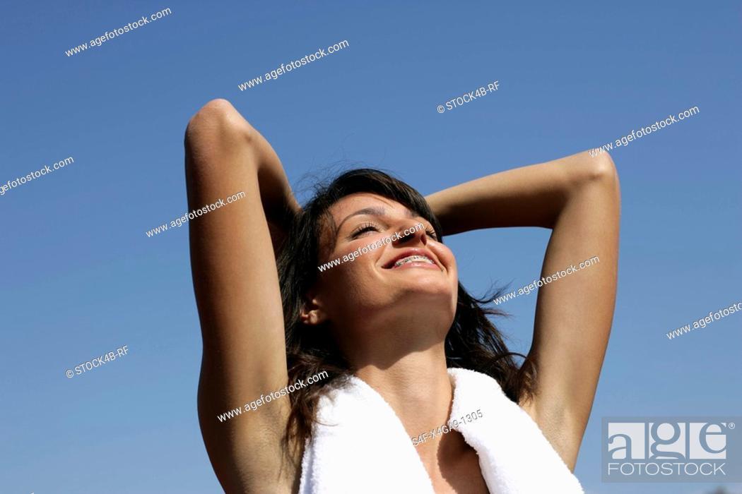 Stock Photo: Woman having a towel around her neck.
