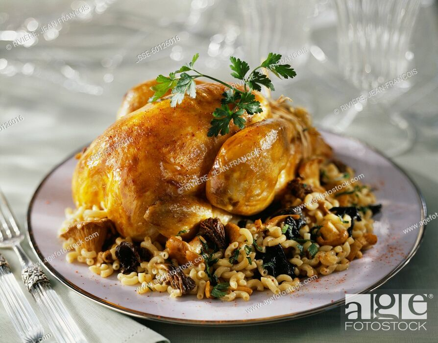 Stock Photo: Roasted capon with mushrooms.