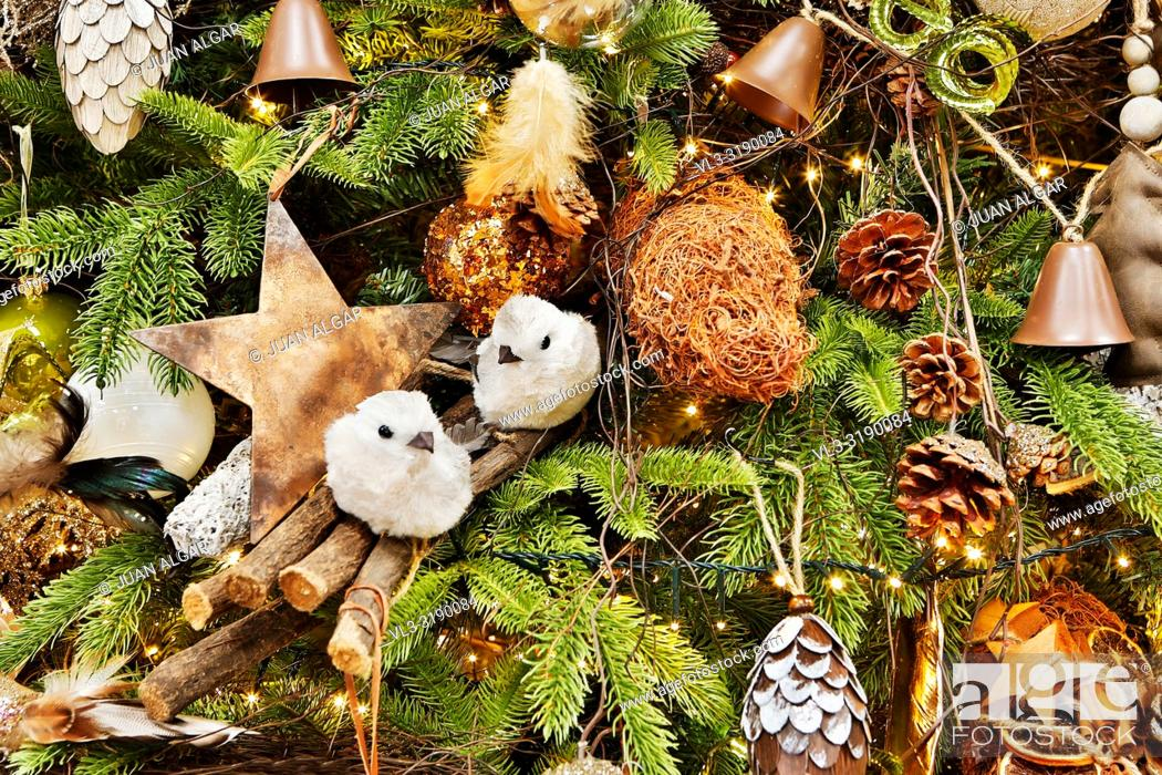 Stock Photo: Background of fir tree branches with various cozy rustic decor and golden burning garland.