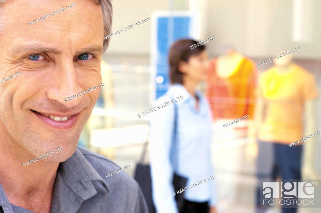 Stock Photo: Man and woman window shopping.