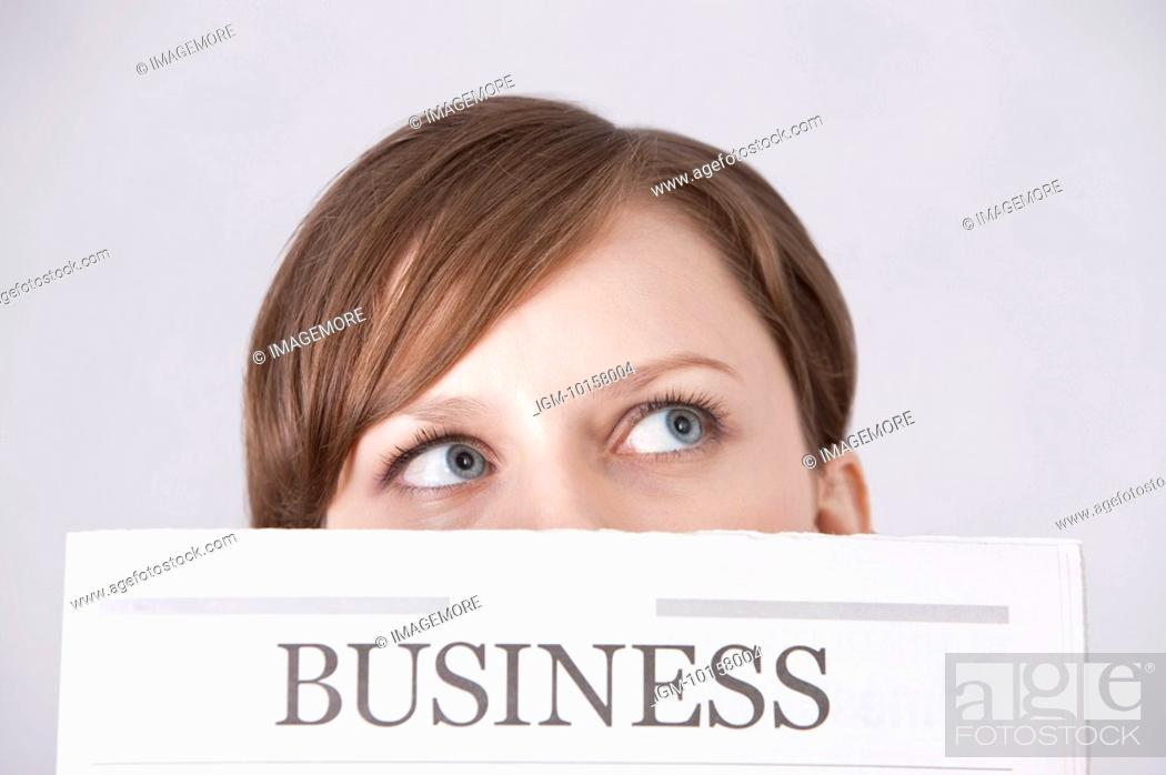 Stock Photo: Close-up of young woman looking up and thinking.
