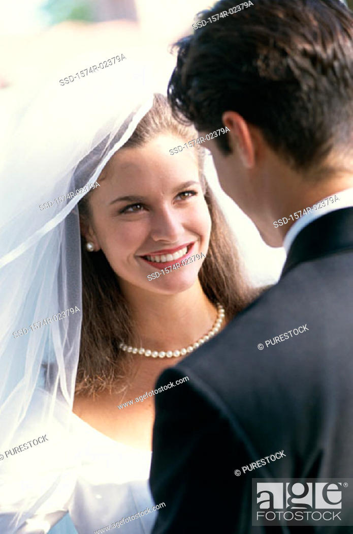Stock Photo: Close-up of a newlywed couple looking at each other.