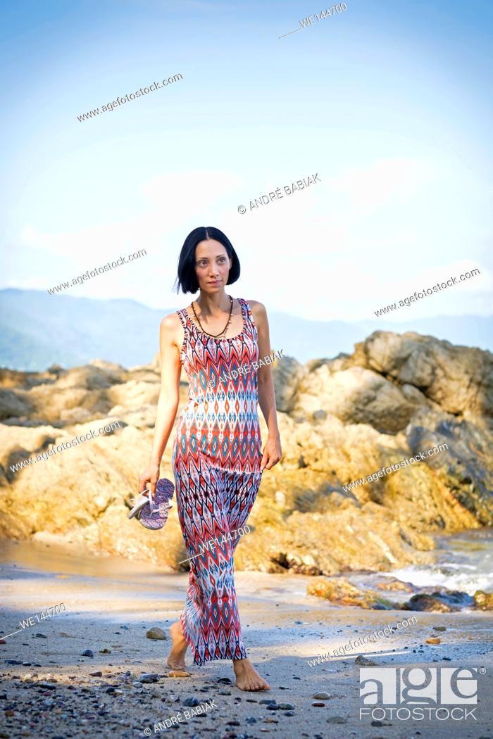 Stock Photo: Asian woman walking at the beach in Puerto Vallarta, Jalisco, Mexico.