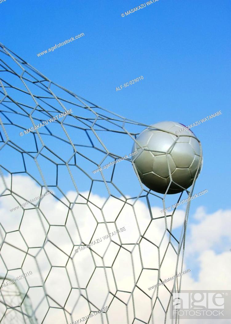 Stock Photo: Soccer Ball in Goal Net.