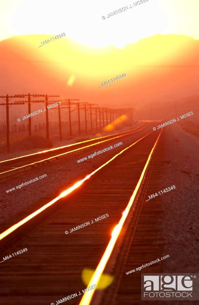 Stock Photo: Train tracks into the sunset.