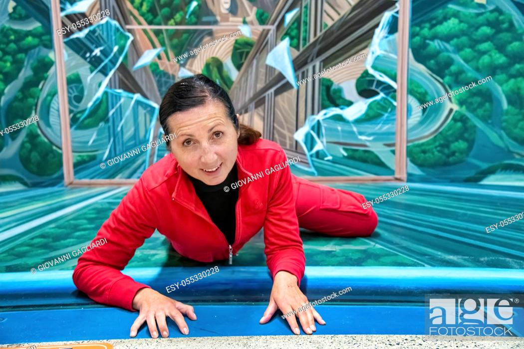 Stock Photo: Happy female climber at the top of an ascent.