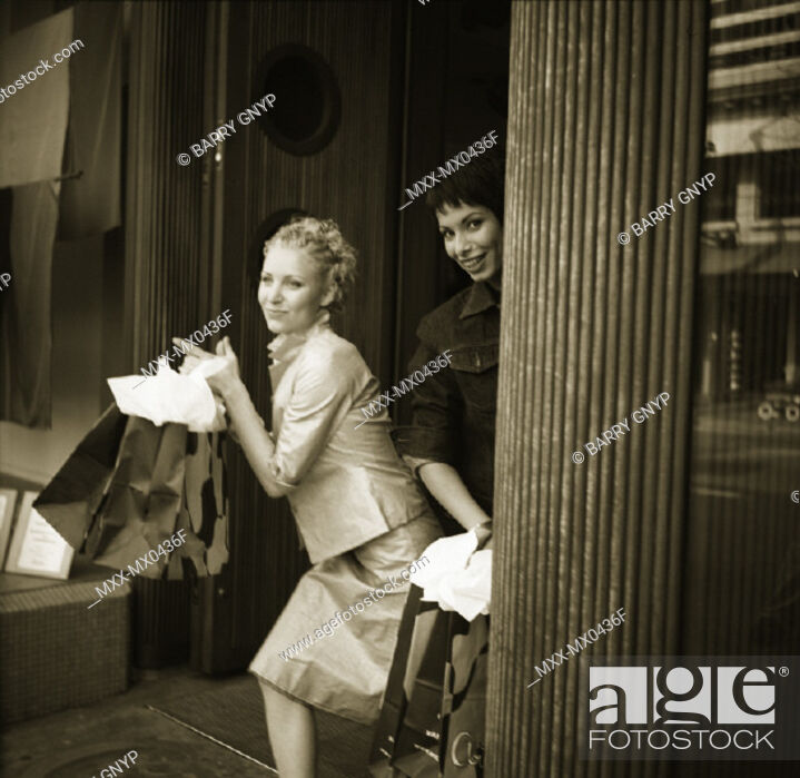 Stock Photo: Two women shopping on Robson St., Vancouver, B.C.