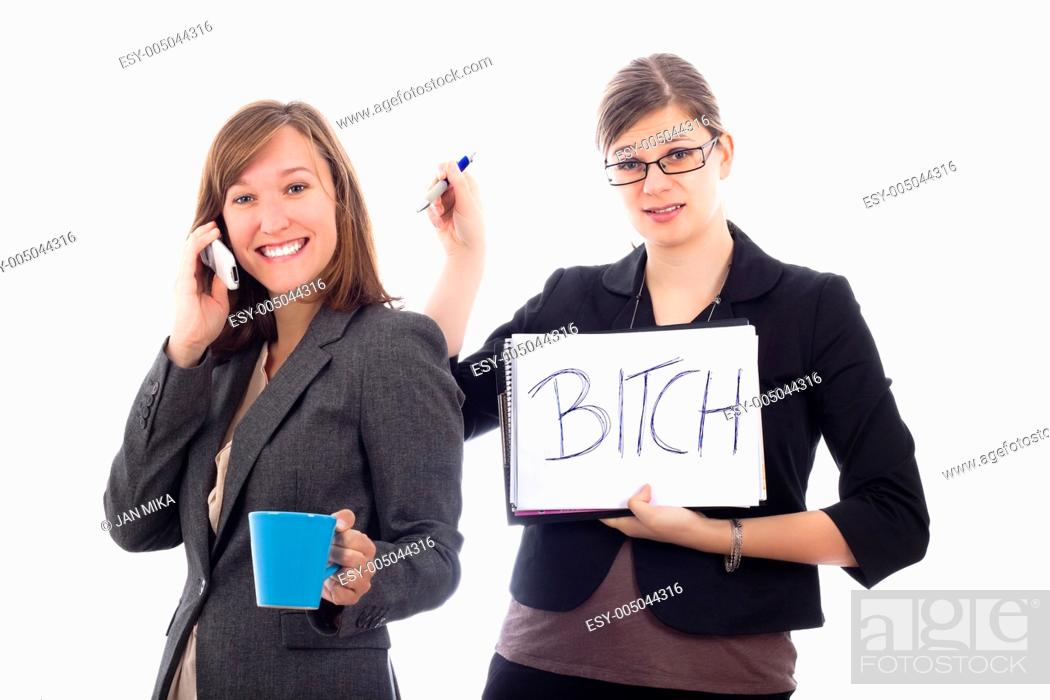 Stock Photo: Two business women colleagues competing concept, isolated on white background.