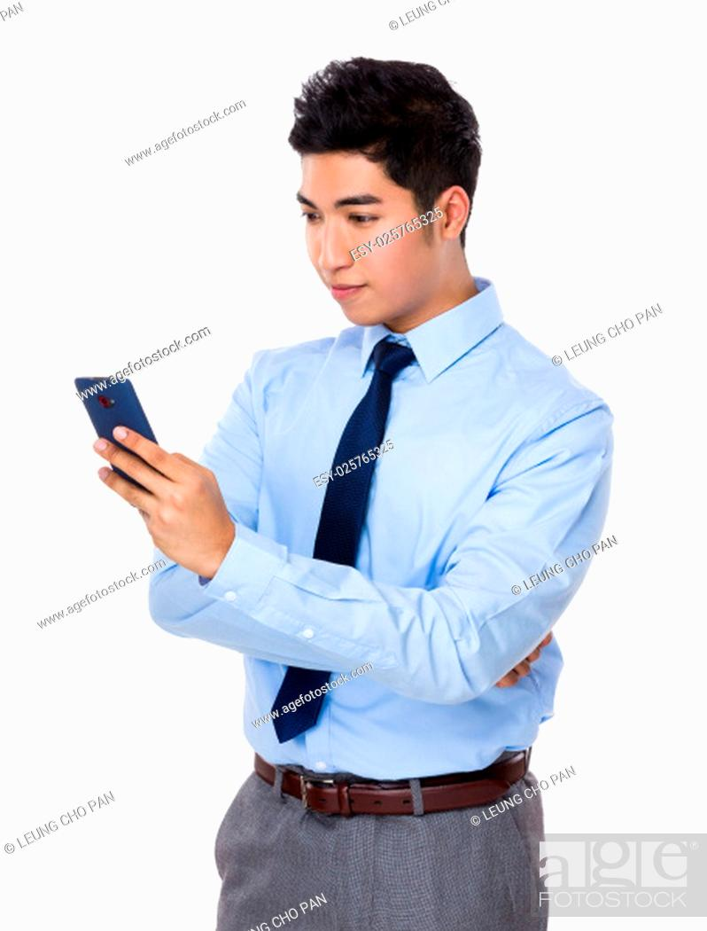 Stock Photo: Asian businessman read on the cellphone.