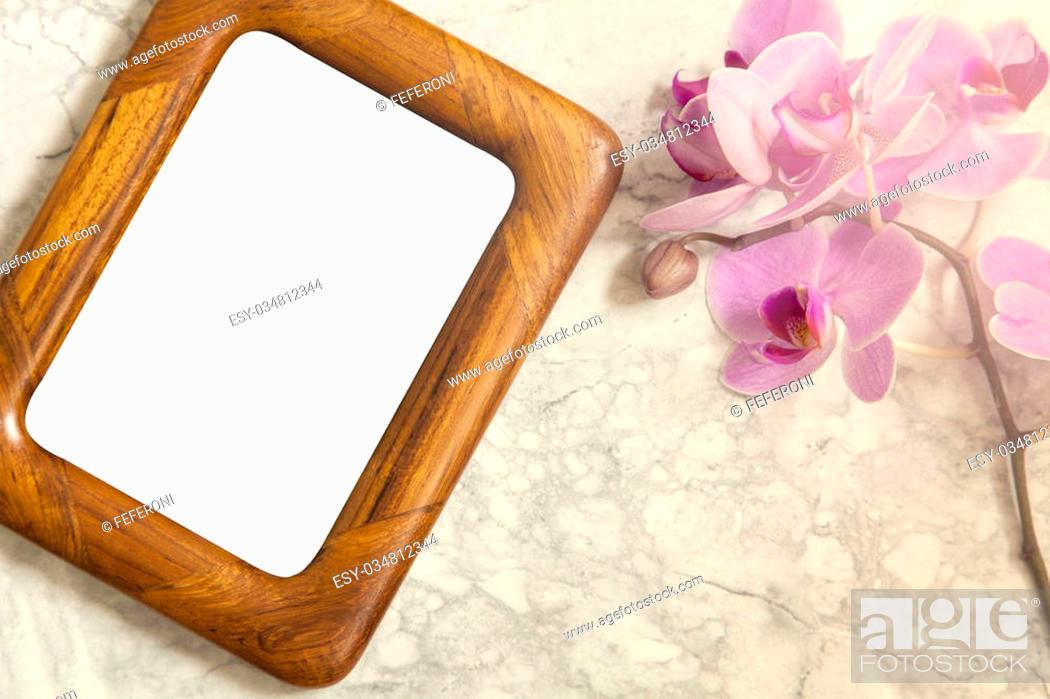 Stock Photo: Image of a flat lay mockup concept with orchids and wooden frame.