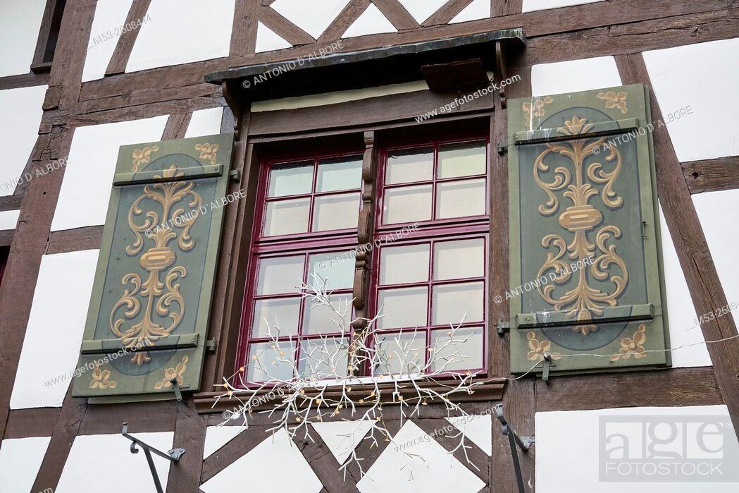 Stock Photo: Exterior of a traditional swiss building with Christmas decoration. Gottlieben Municipality. Kreuzlingen District. Thurgau Canton. Switzerland.