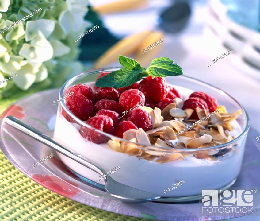 Stock Photo: Raspberries and fromage blanc.