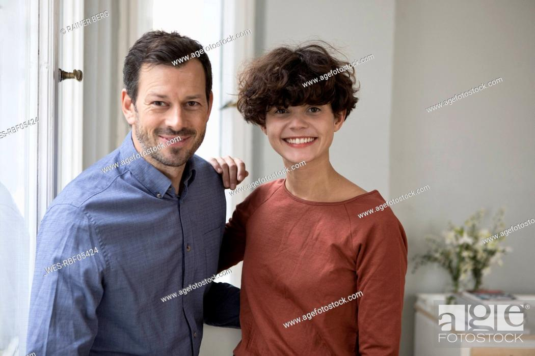 Stock Photo: Portrait of happy couple at home.