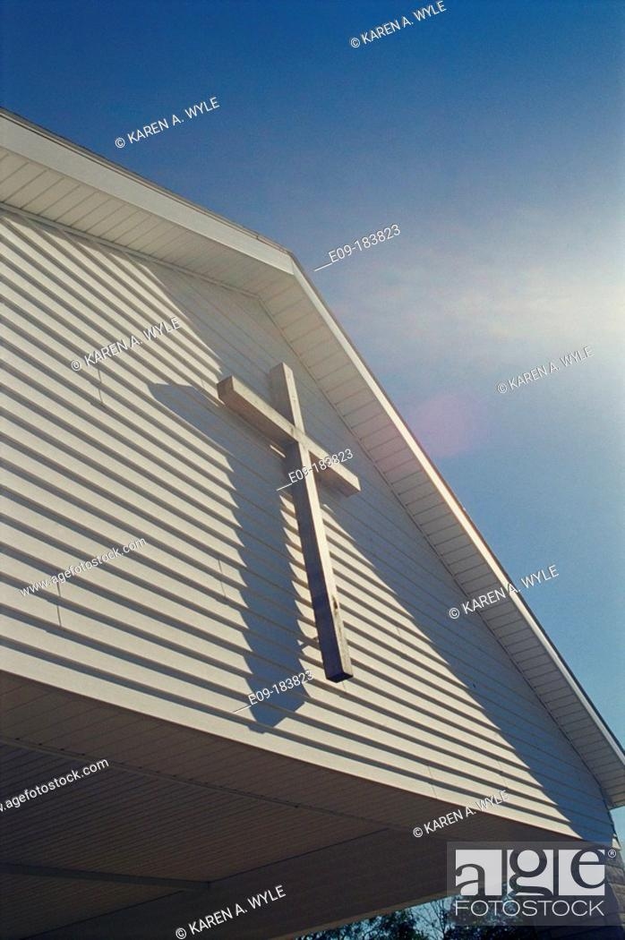 Stock Photo: Cross on front of rural Christian church, sunlit, Monroe County, Indiana, USA.