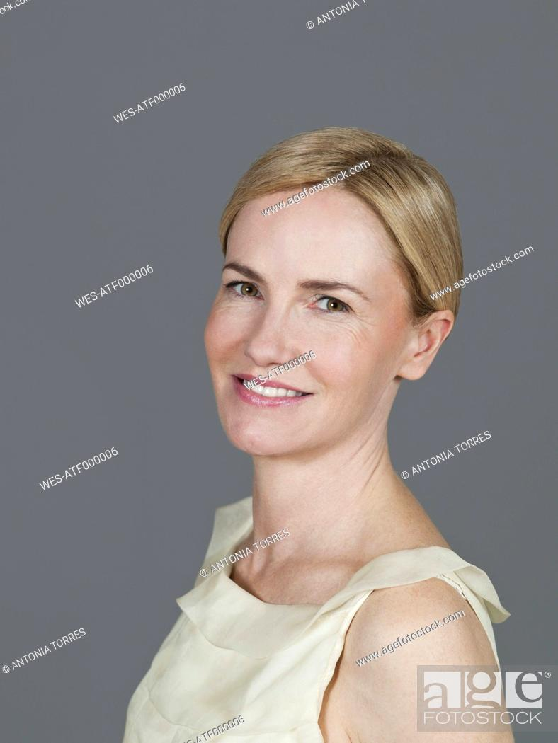 Stock Photo: Mature woman smiling, portrait.
