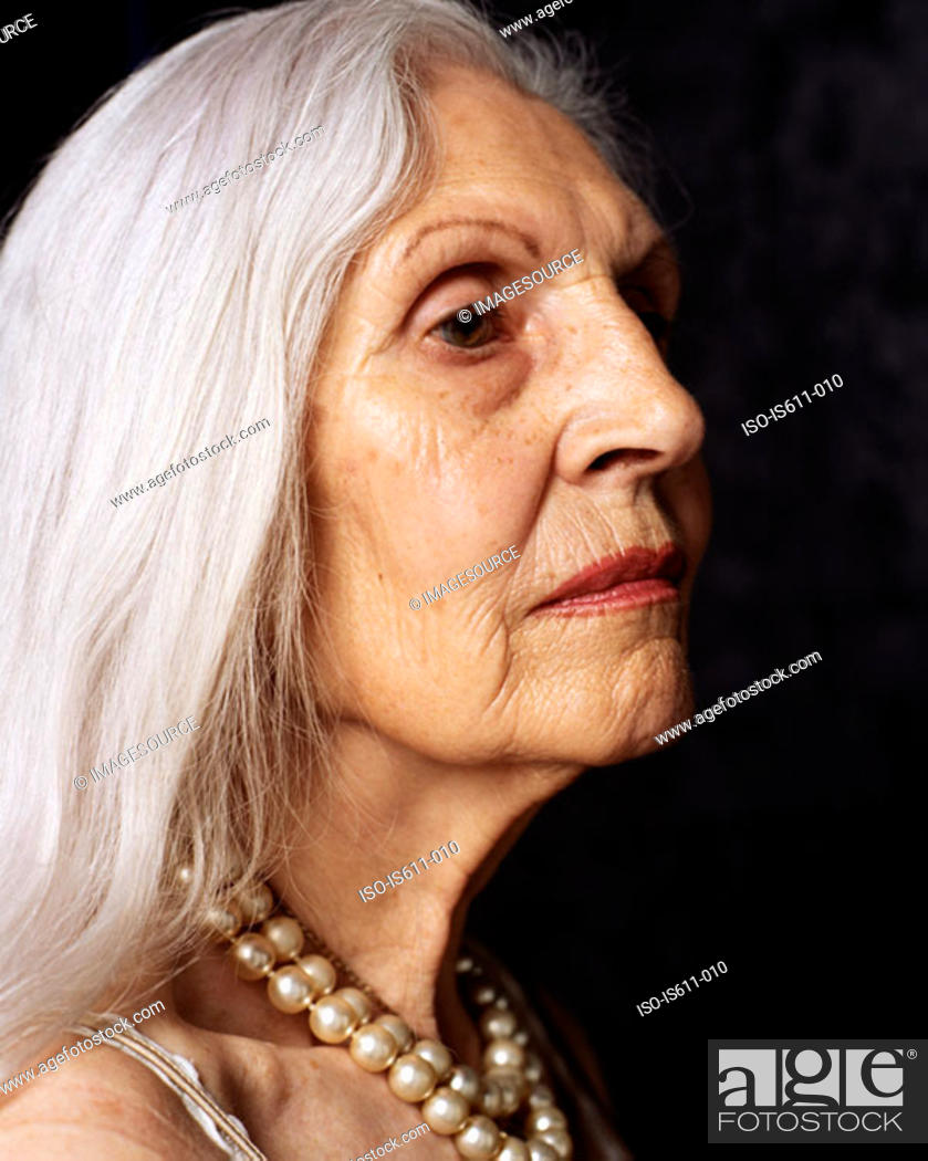 Stock Photo: Senior woman looking serious.