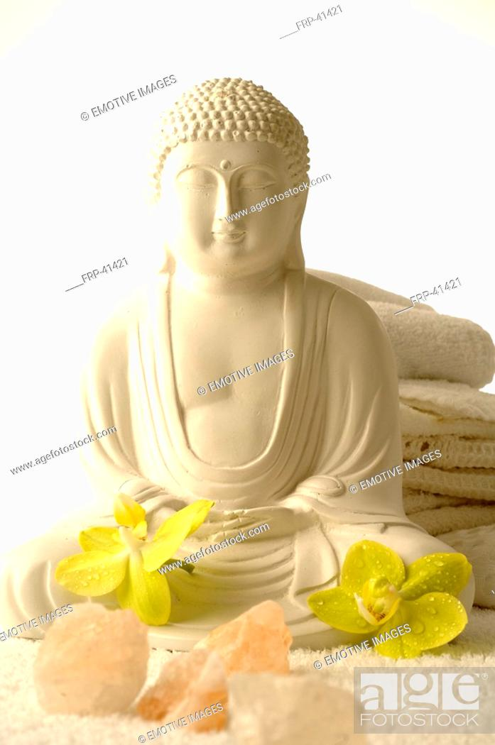 Stock Photo: Buddha with orchid blossoms and salt crystals.