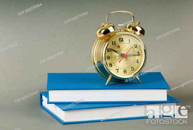 Imagen: Back to school concept with books and clock.