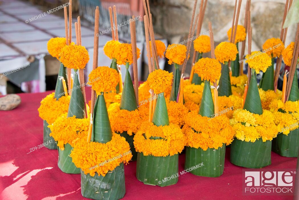 Stock Photo: Floral offerings for sale, to be placed at the temple at Vat Sene, 2/16.