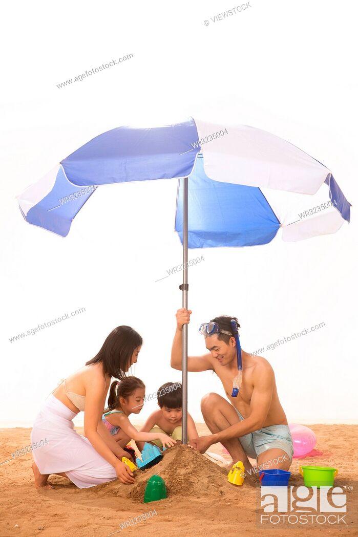 Stock Photo: Happy family play on the beach.