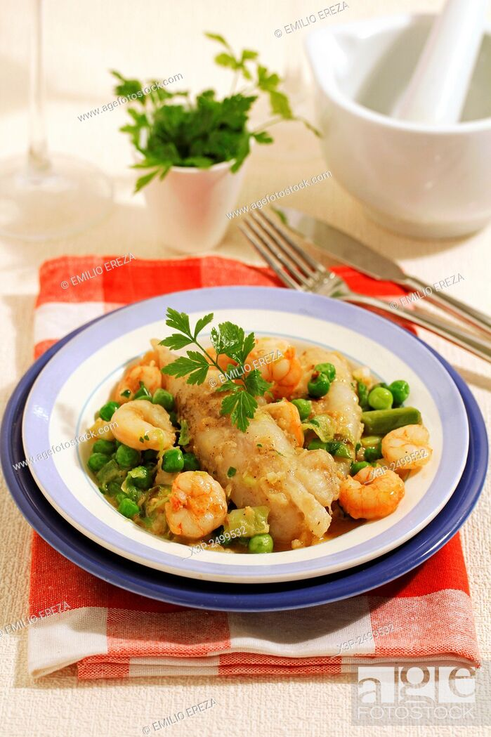 Stock Photo: Monkfish tails with prawns and young garlics.