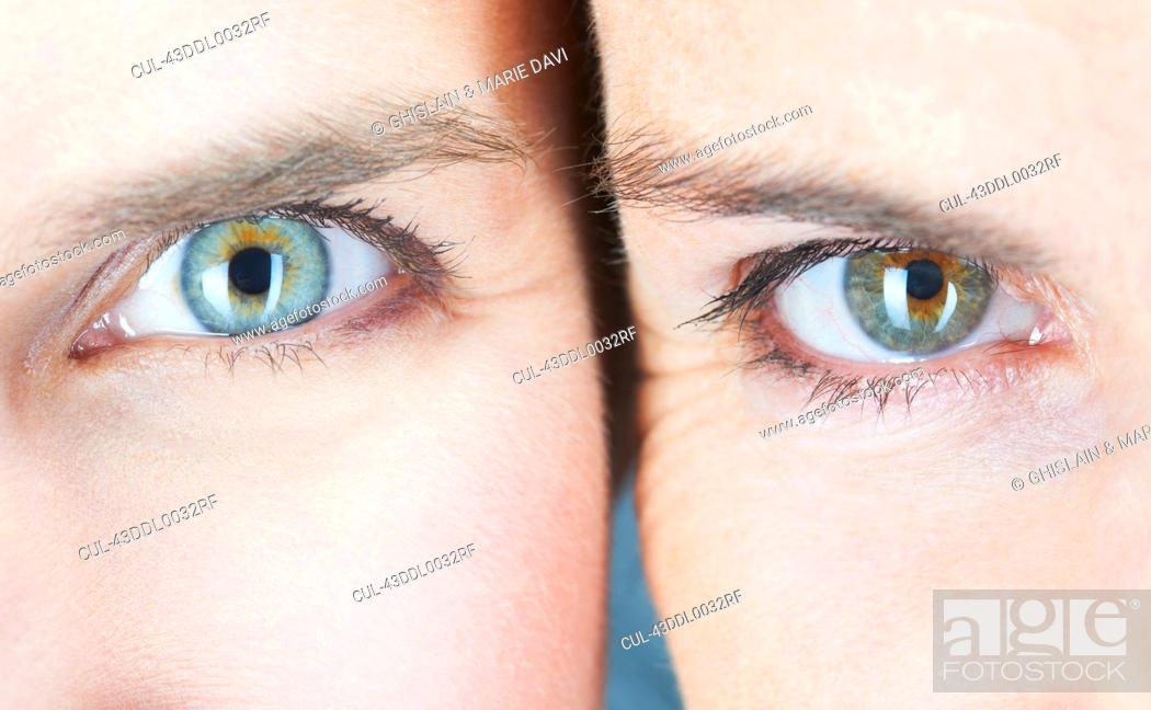 Stock Photo: Close up of two womens eyes.