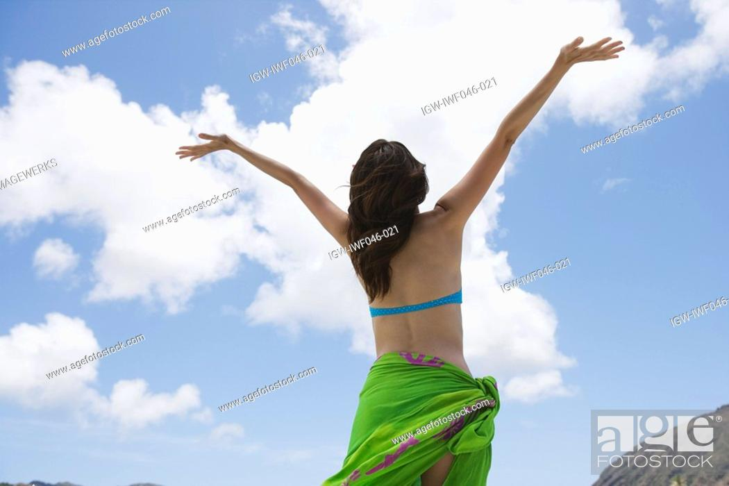 Stock Photo: Rear view of a woman with arms out.