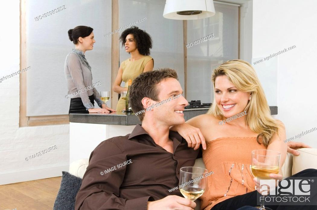 Stock Photo: Friends talking at a dinner party.