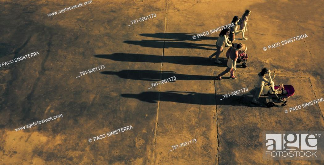 Stock Photo: group of people with projected shadow, Valencia, Spain.