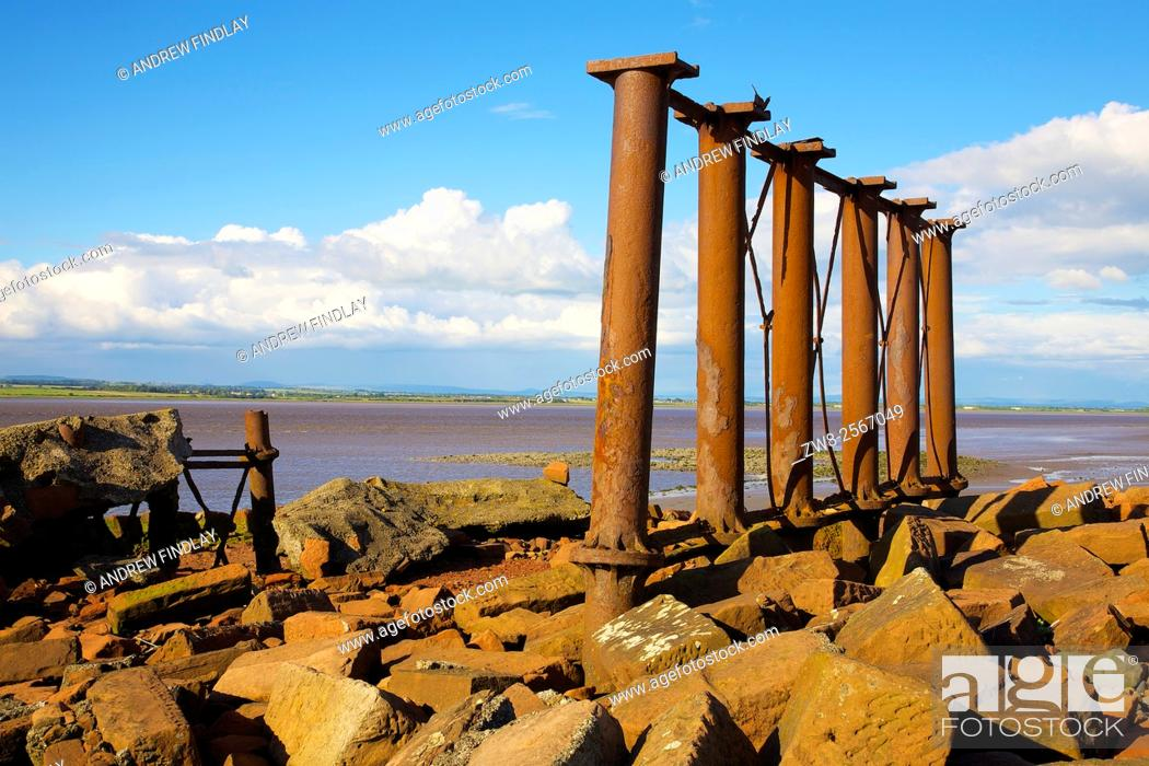 Stock Photo: Solway Coast. Ruined remains of the Solway Viaduct, Solway Junction Railway. Herdhill Scar, North Plain, Bowness on Solway, Solway Coast, Cumbria, England.