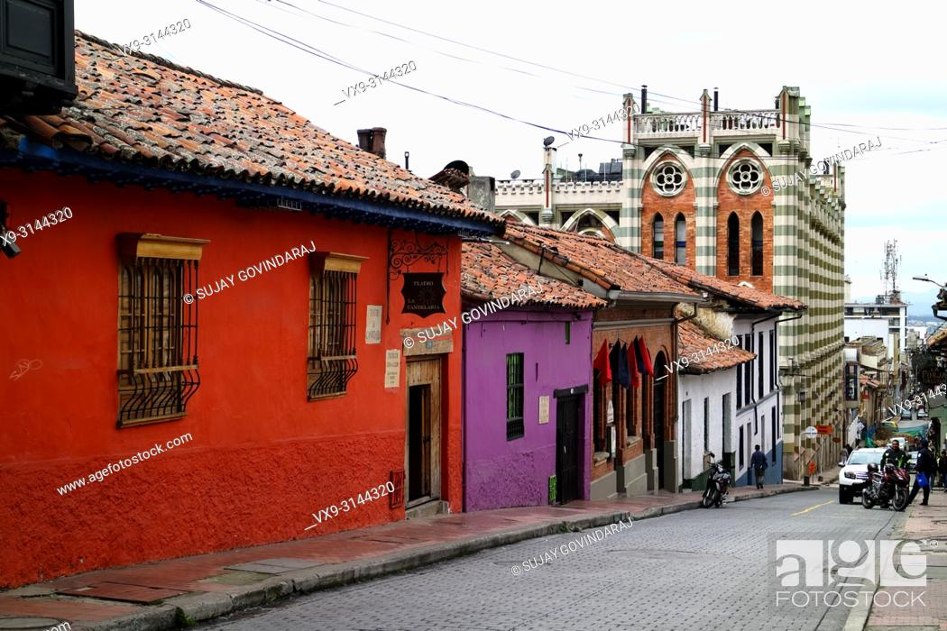 Stock Photo: Bogota, Colombia - January 27, 2017: Looking down one of the streets in the La Candelaria district in the capital city of Bogota in the South American country.