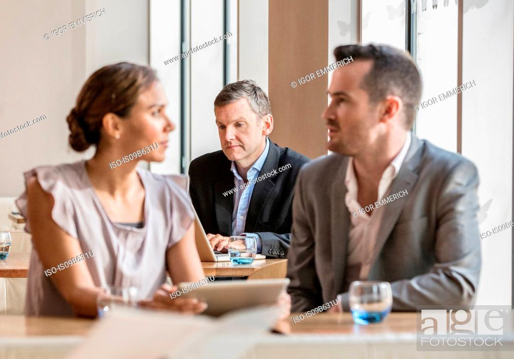 Stock Photo: Businessmen and businesswoman working.