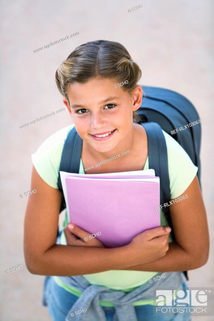 Stock Photo: School girl 10-13 waiting, from above.
