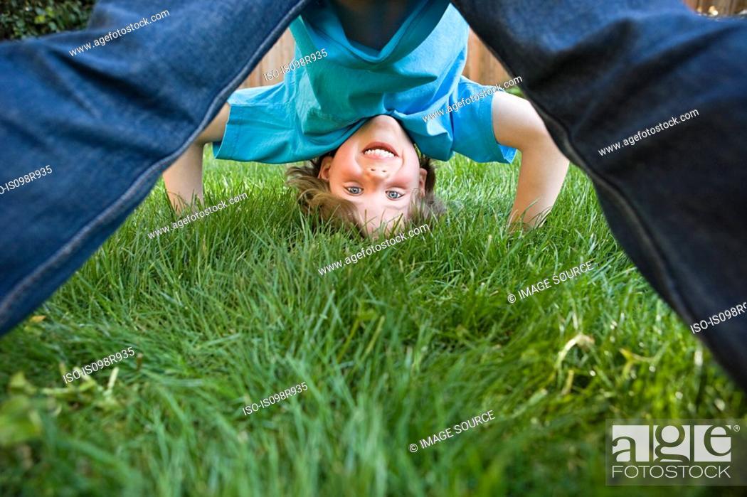 Stock Photo: Boy playing on grass.