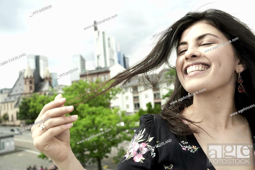 Photo de stock: Portrait of happy young woman. Frankfurt am Main. Germany.