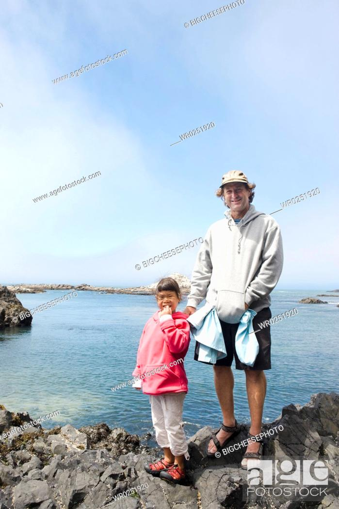 Stock Photo: Father and daughter enjoying seaside stroll.