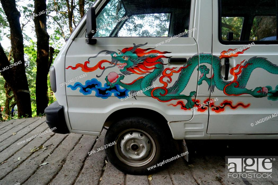 Stock Photo: Car painted with Chinese dragon, Landour, Mussoorie, Uttarakhand, India, Asia.