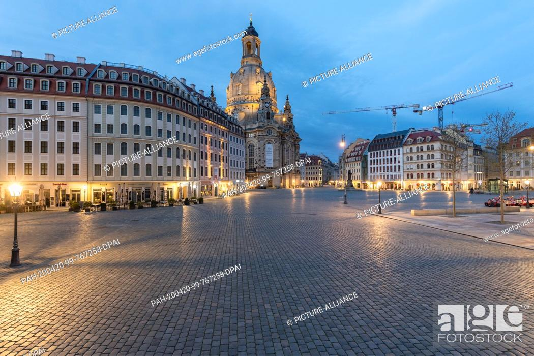 Stock Photo: 18 April 2020, Saxony, Dresden: The Neumarkt in front of the Frauenkirche (M) and the Museum of Transport (l) is deserted.