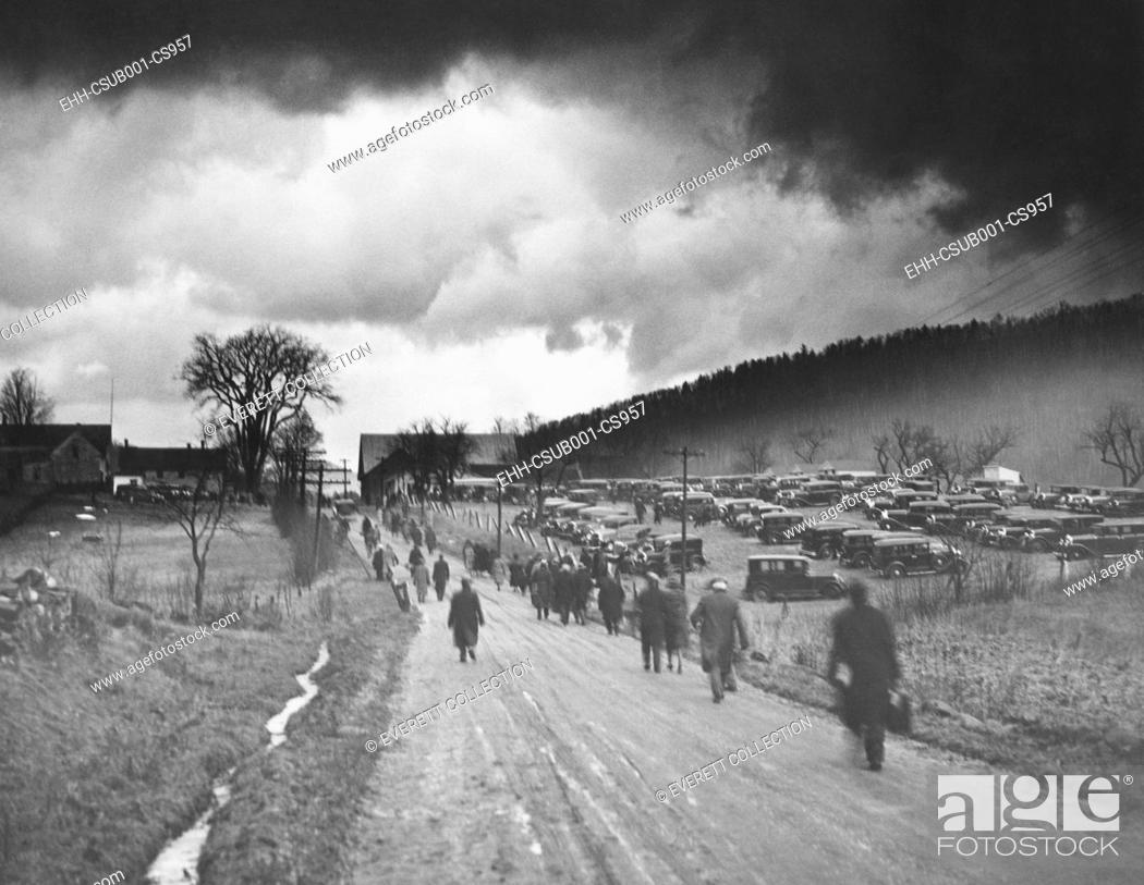 Stock Photo: Former President Calvin Coolidge laid to rest in Plymouth, Vermont. Jan. 7, 1933. Heavy dark clouds hover over the road to Plymouth, Vermont.