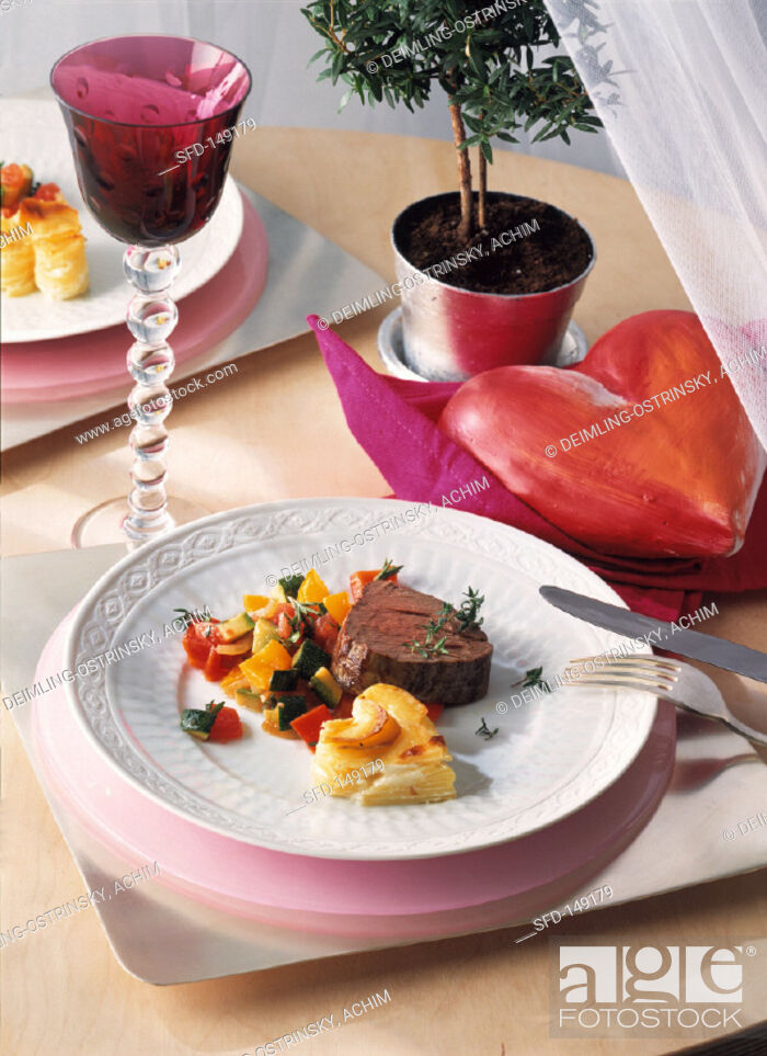 Stock Photo: Fillet of Beef with Potatoes and Vegetables.